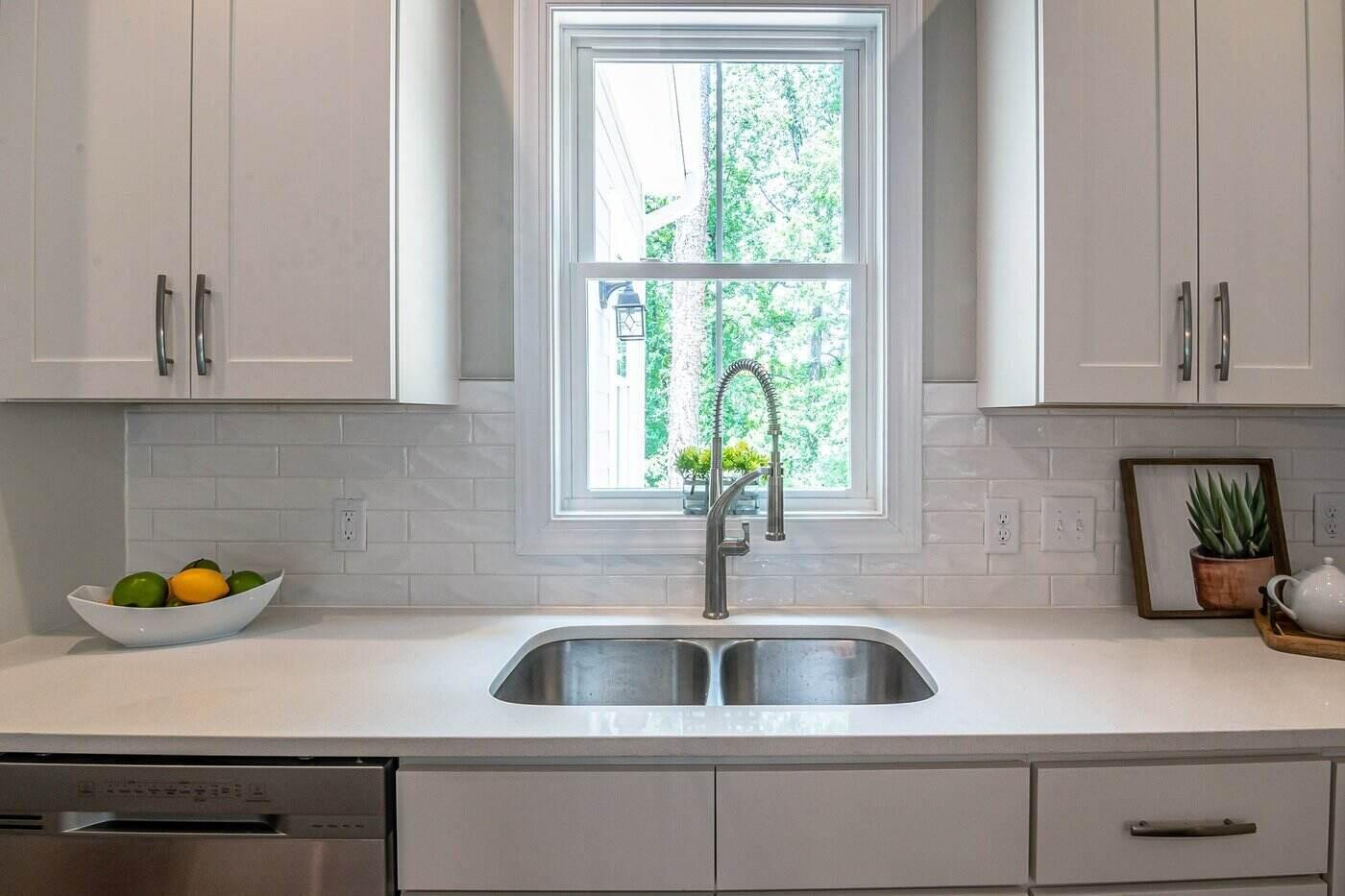 window flanked by kitchen cabinets - eco-friendly kitchen cabinets