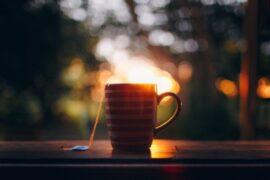 mug of tea on windowsill at sunset - tips on designing a safe and comfortable home