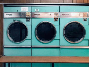 row of washing machines - 5 things that might shorten the life of your washing machine