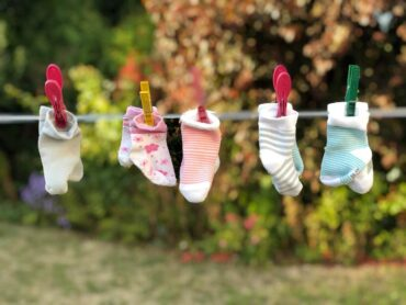 baby socks on clothesline - 8 tips for a sustainable household