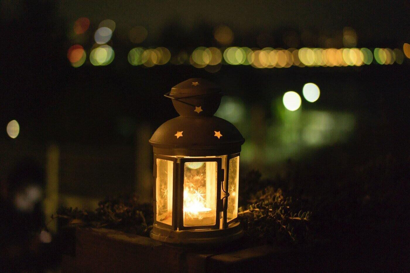 candle burning in lantern at dusk - best non toxic environmentally friendly candles