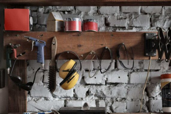 tools hanging on board in garage - essential tools for DIY projects