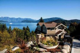 house on hill overlooking lake - transform your home into an eco-friendly space