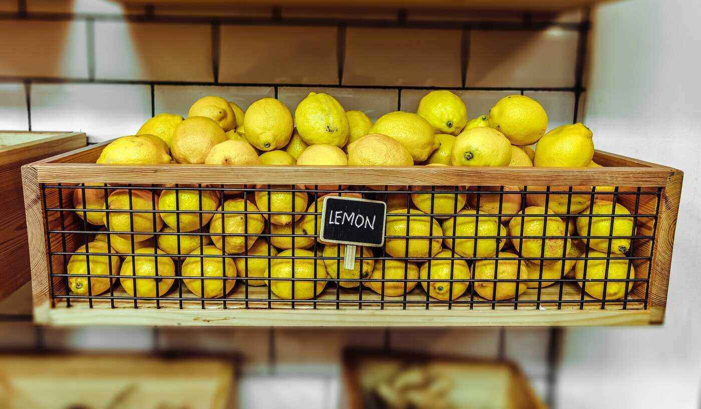 lemons in crate with sign - tips for cleaning your house the eco-friendly way