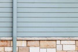 grey siding and brick - 5 eco-friendly siding options