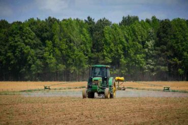 tractor spraying crop - the not-so-secret dangers of paraquat and how it affects you
