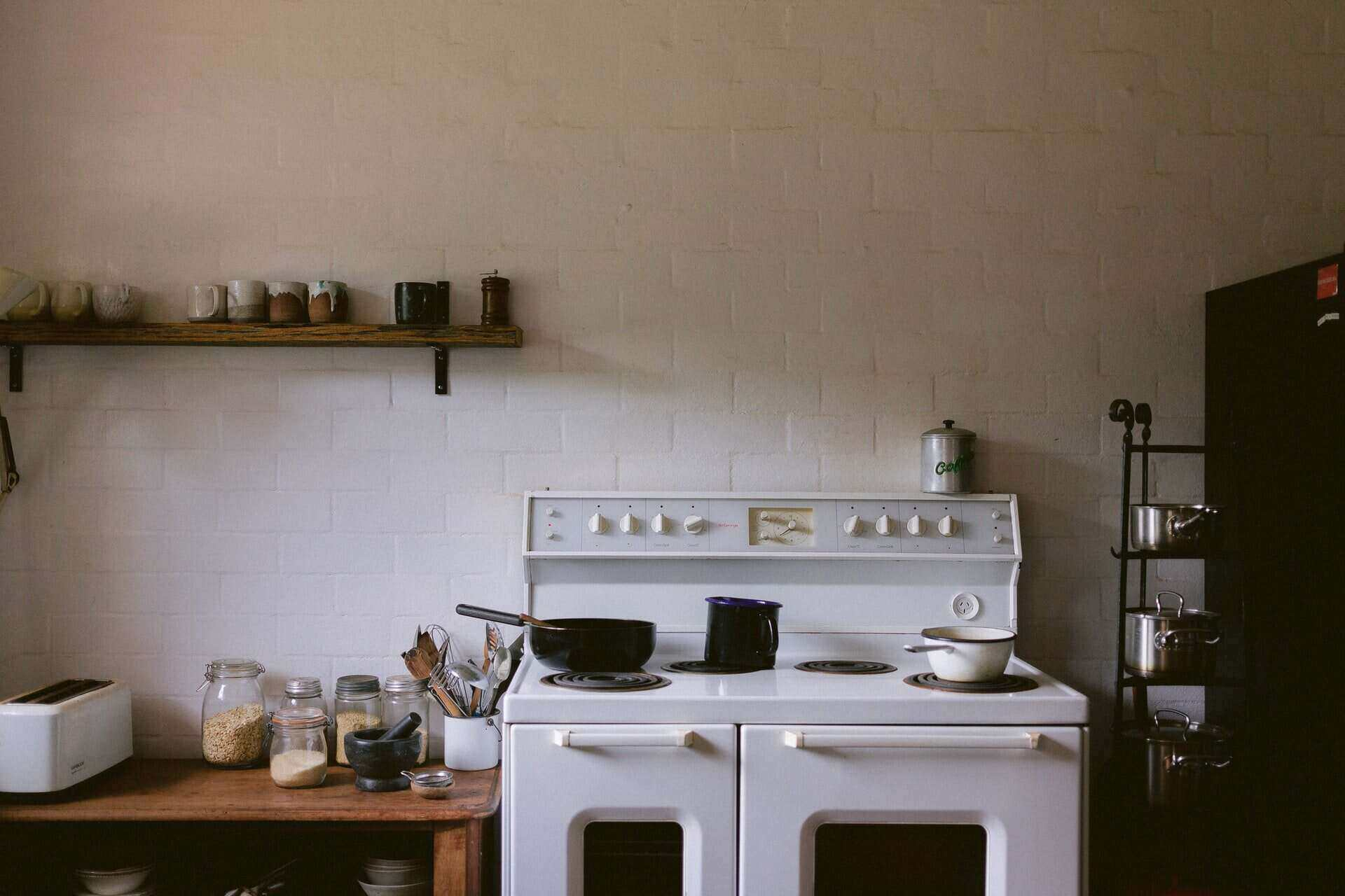 old-fashioned white stove - genius hacks for an energy-efficient kitchen